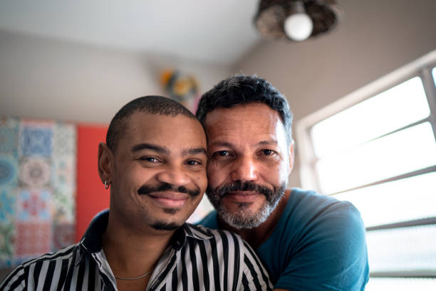 Portrait of a homosexual couple at home stock photo
