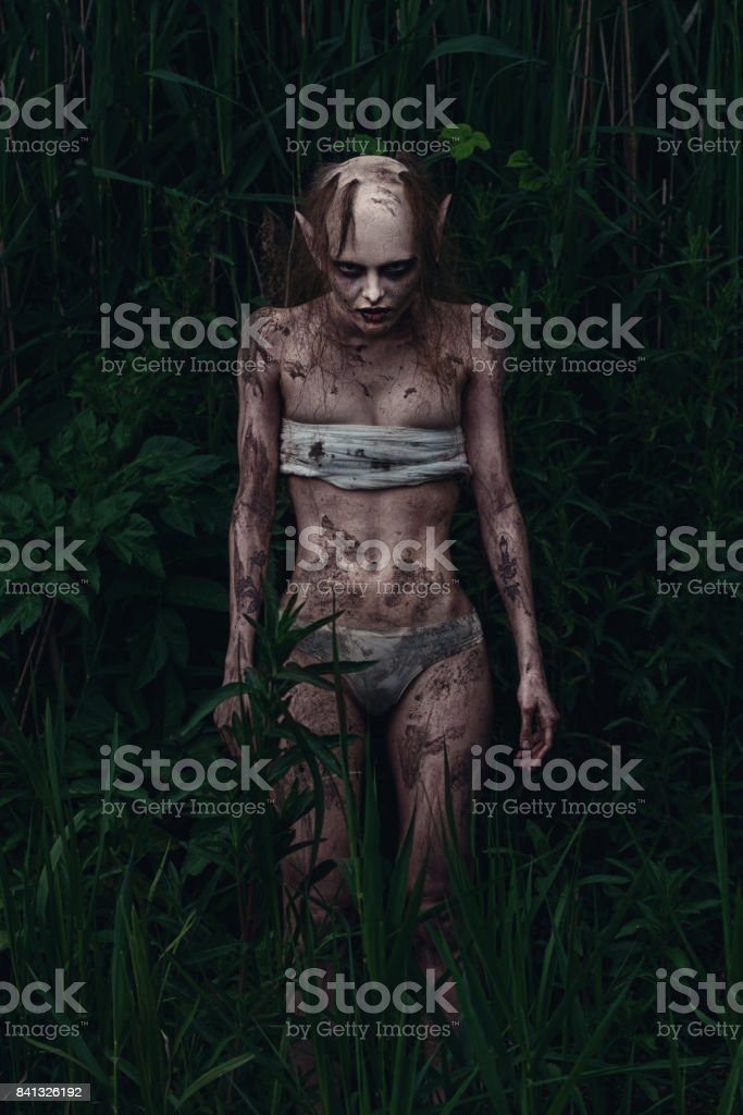 Portrait of a horrible scary fantasy style mystic creature. Horror or Halloween concept. stock photo