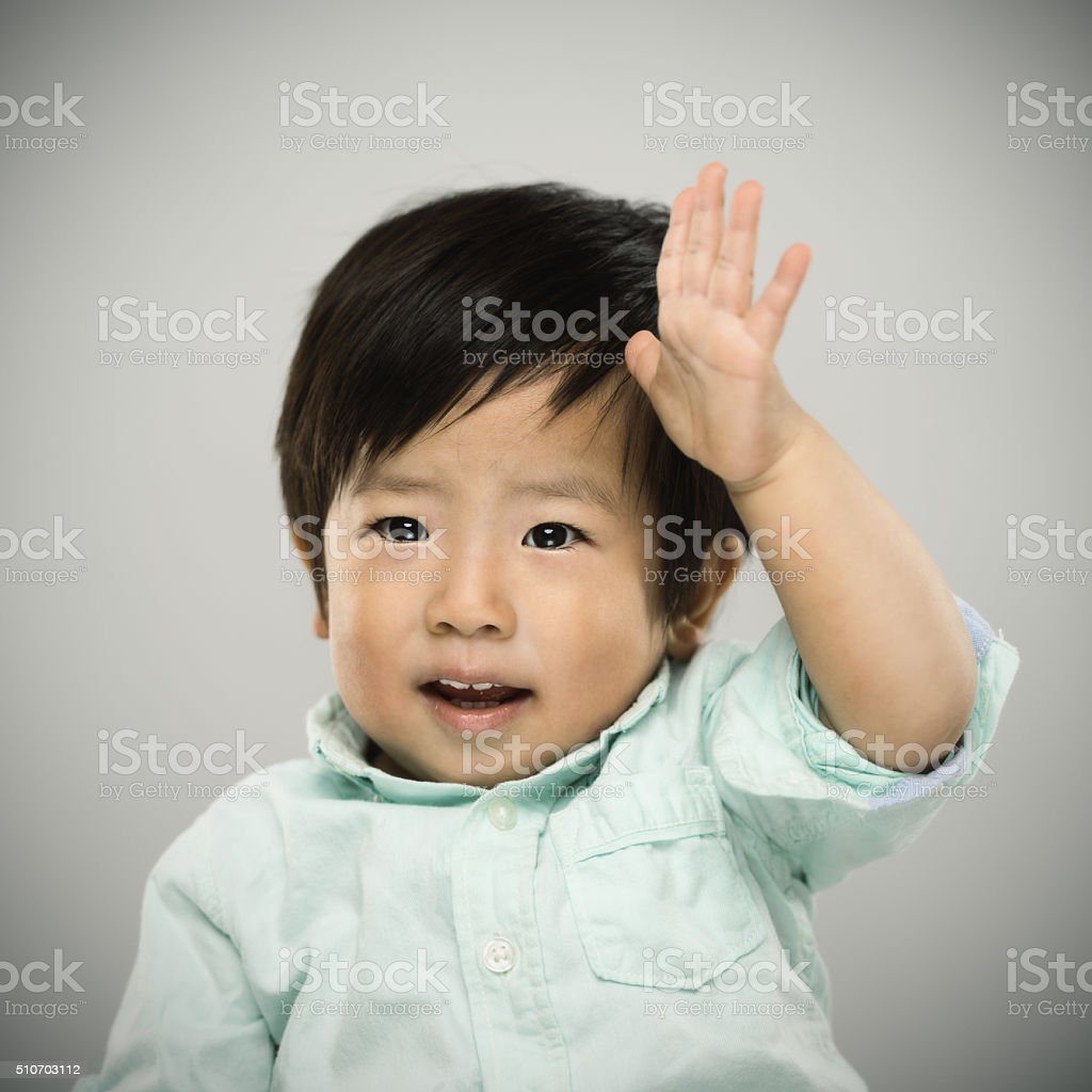 Portrait Of A Japanese Baby Raising His Hand Up Stock Photo More
