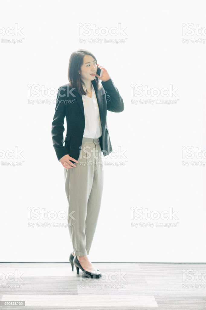 Portrait of a Japanese business woman with smartphone stock photo