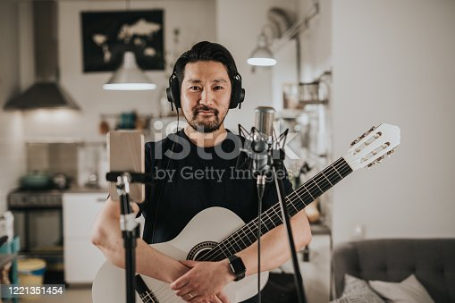 istock Portrait of a Japanese guitar player at home studio 1221351454