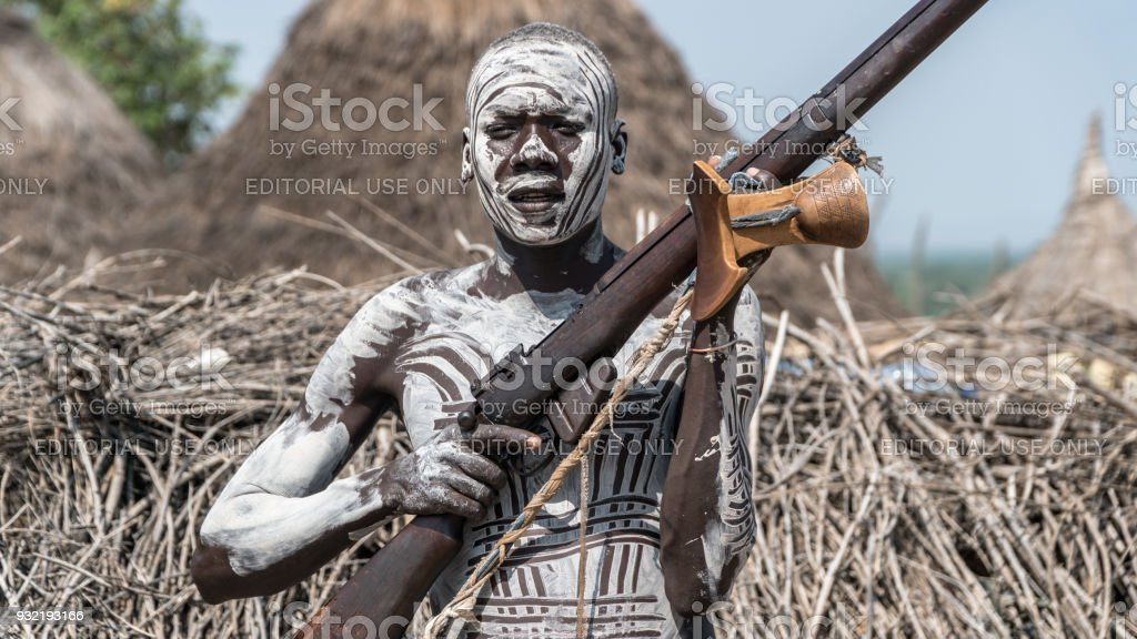 Portrait of a Karo tribe man with his gun stock photo