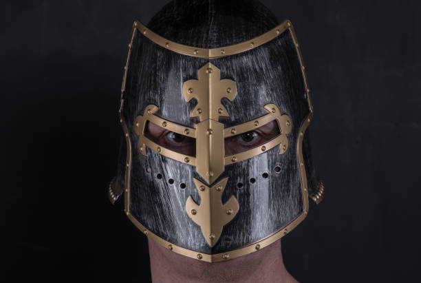 portrait of a knight in a helmet - knights templar stock pictures, royalty-free photos & images