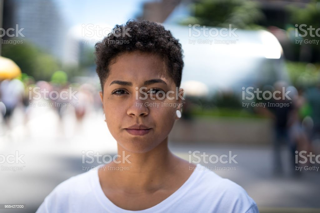 Portrait of a latin girl in the city stock photo