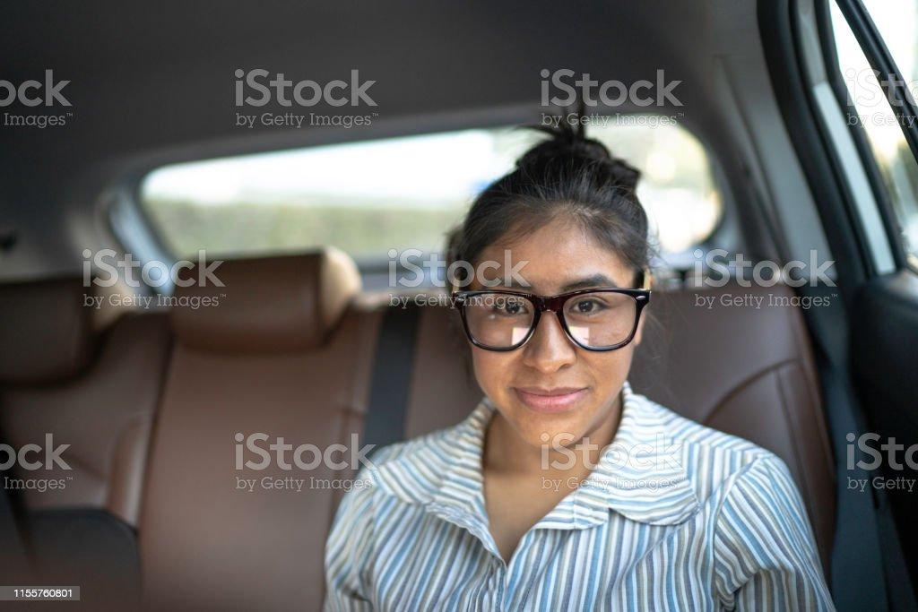 Portrait of a latin woman inside a cab