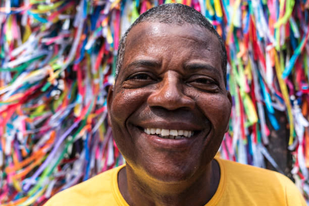 portrait of a latino man smiling - caribbean culture stock pictures, royalty-free photos & images