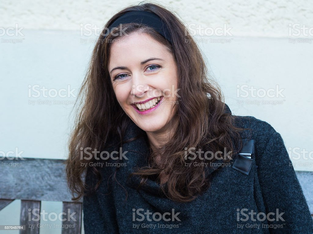 Portrait of a laughing brunette young woman stock photo