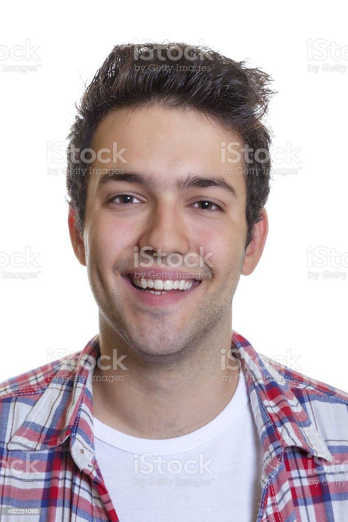 Portrait of a laughing hispanic guy stock photo
