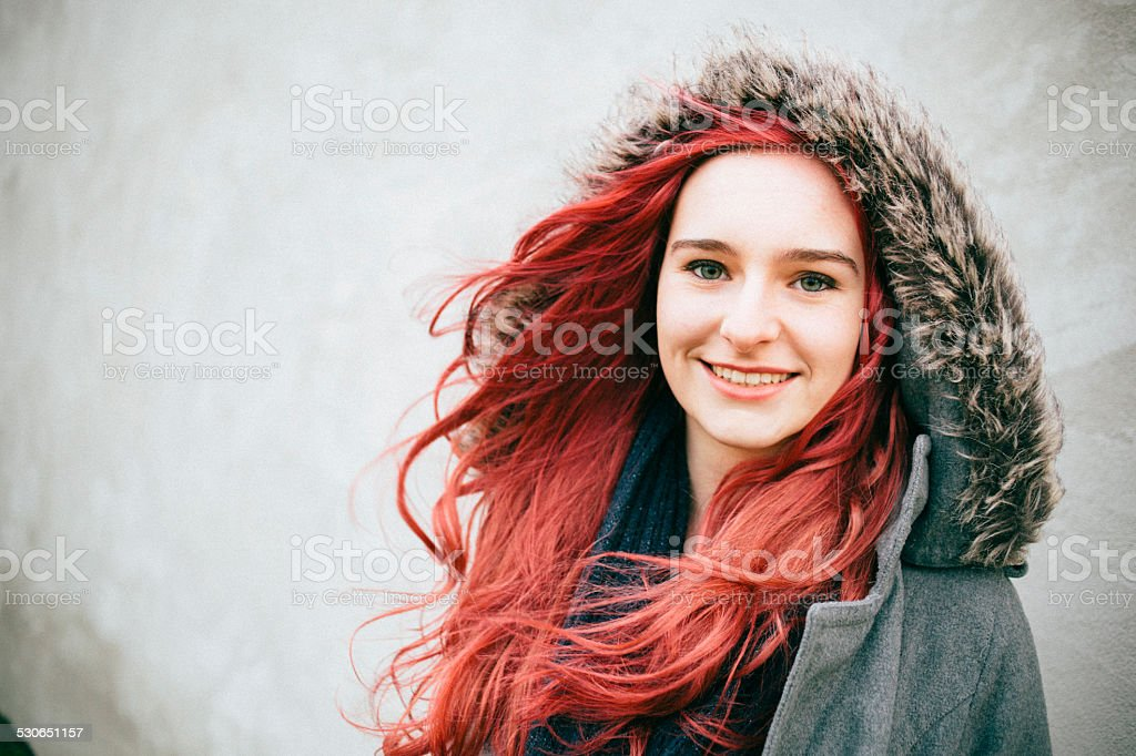 portrait of a laughing redhead teenager girl, looking at camera stock photo