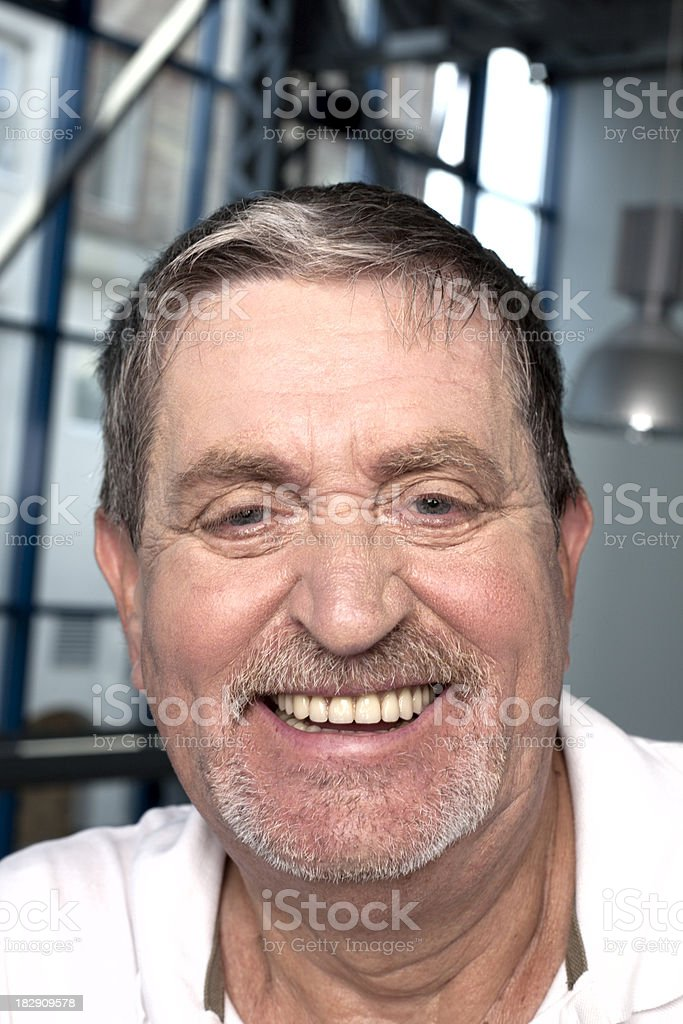 Portrait of a laughing senior man stock photo