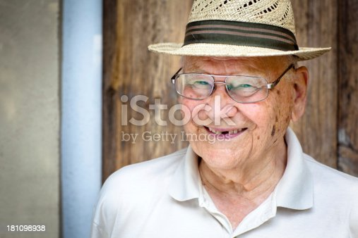 istock portrait of a laughing senior man with a straw hat 181098938