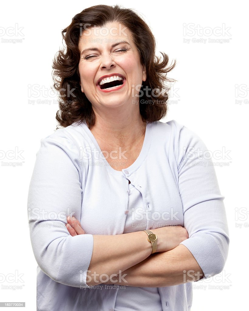 Portrait of a laughing woman standing with her arms folded royalty-free stock photo