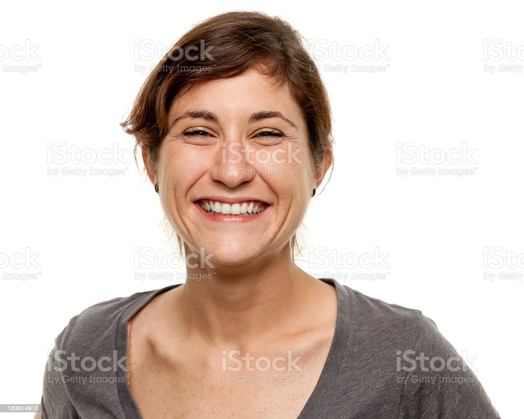Portrait of a laughing young woman over white background stock photo