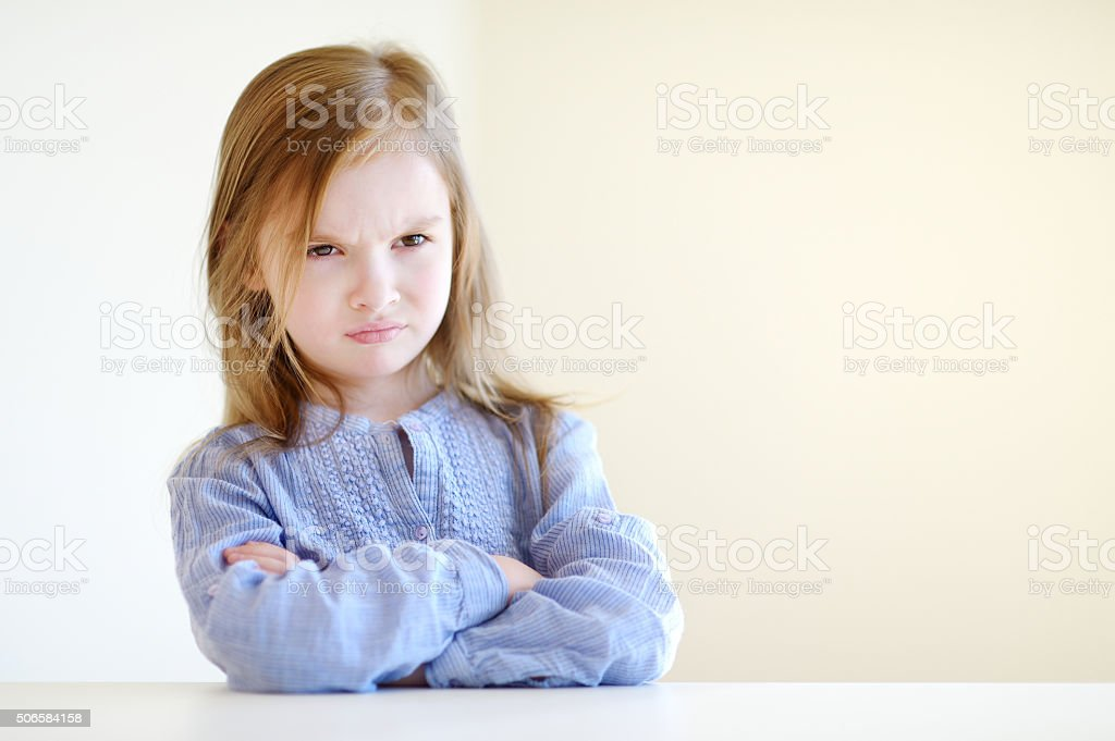 Portrait of a little angry girl stock photo