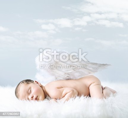 istock Portrait of a little baby as an angel 477260352