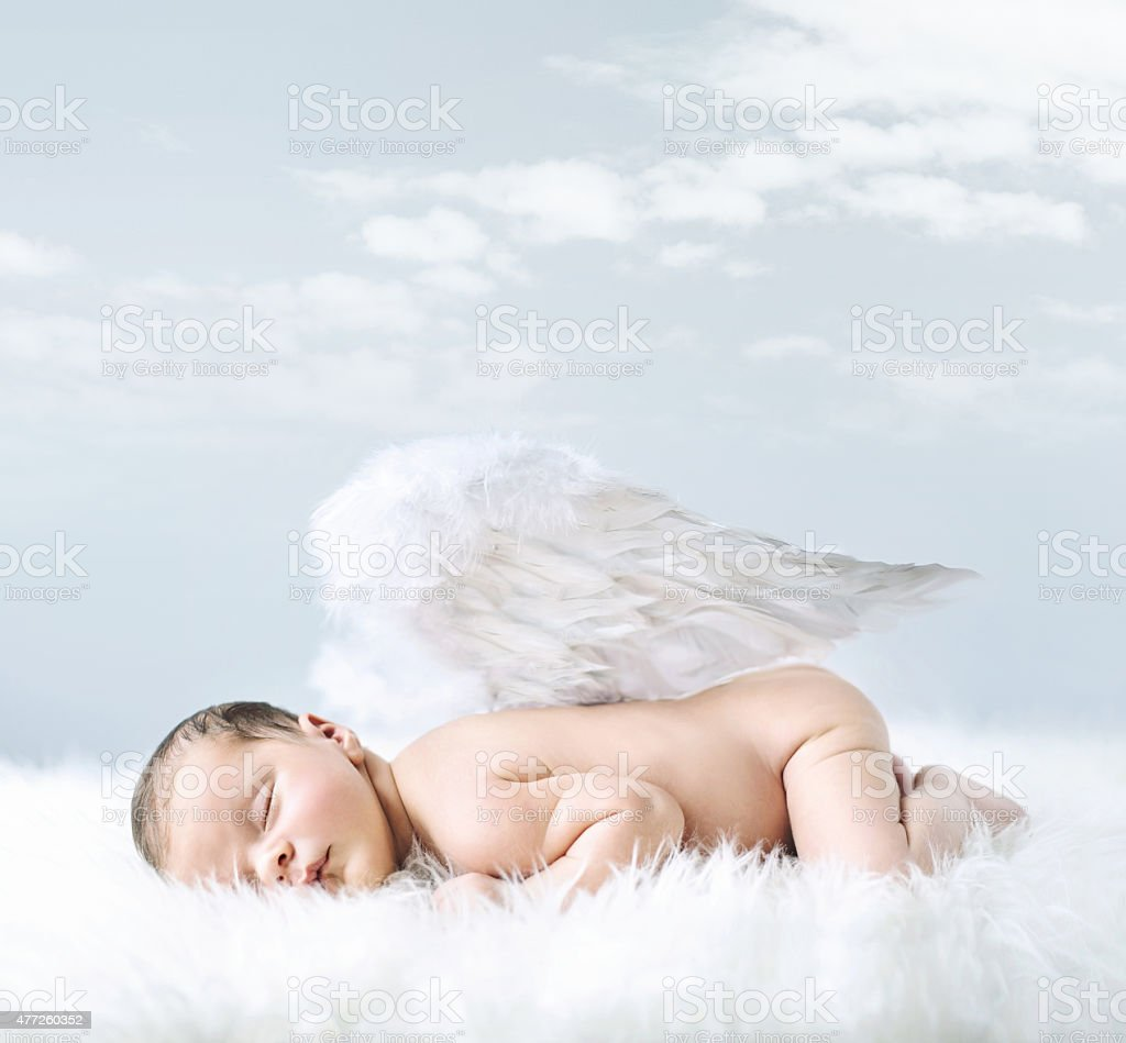 Portrait of a little baby as an angel stock photo