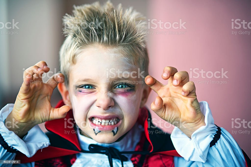 Portrait of a little boy dressed up as halloween vampire stock photo