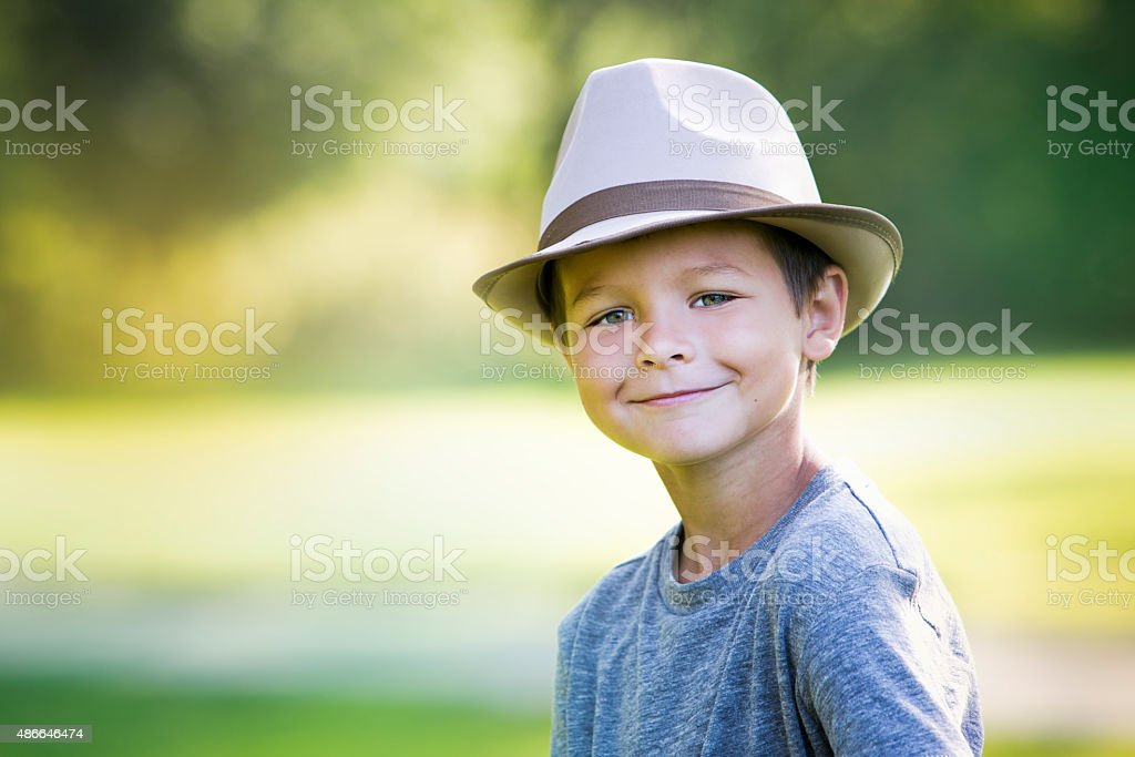 9c24731b7e1 Portrait Of A Little Boy Wearing Hat Stock Photo   More Pictures of ...