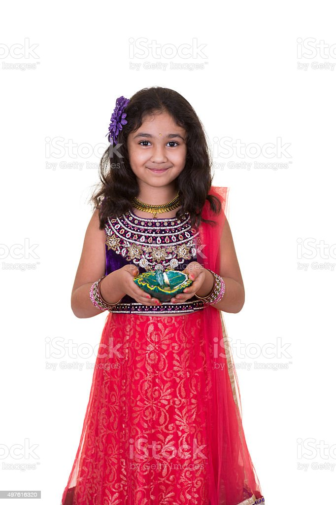 Portrait of a Little Girl Holding a Lamp stock photo