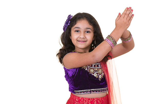 Portrait of a Little Girl in Indian Dance Pose stock photo
