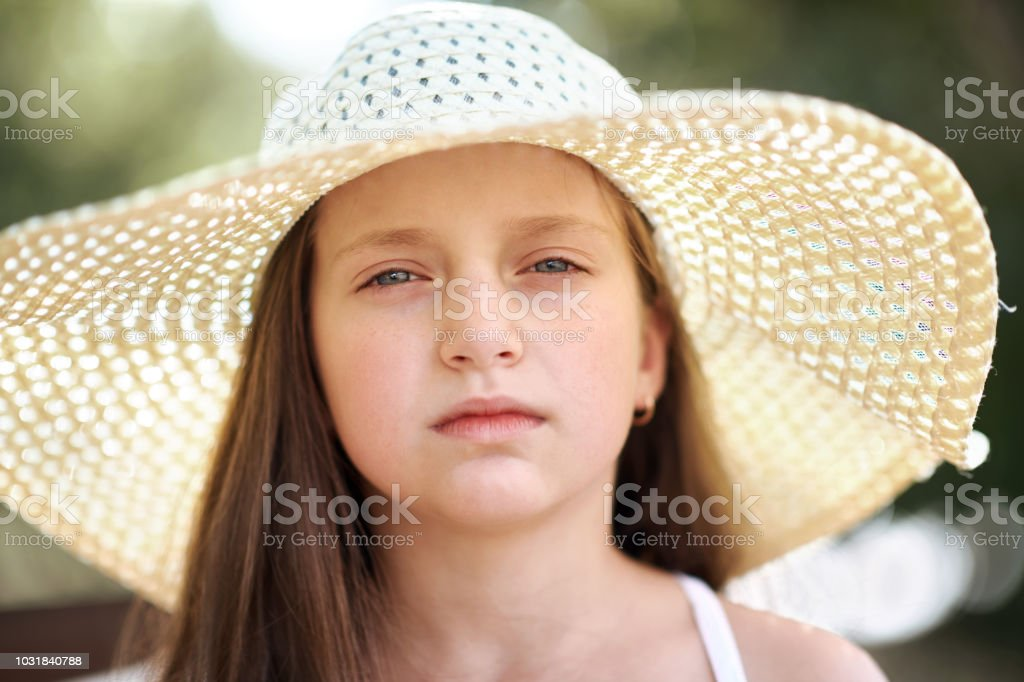 802fe1840 Portrait Of A Little Girl Wearing A Big Hat Beautiful Sunny Day ...