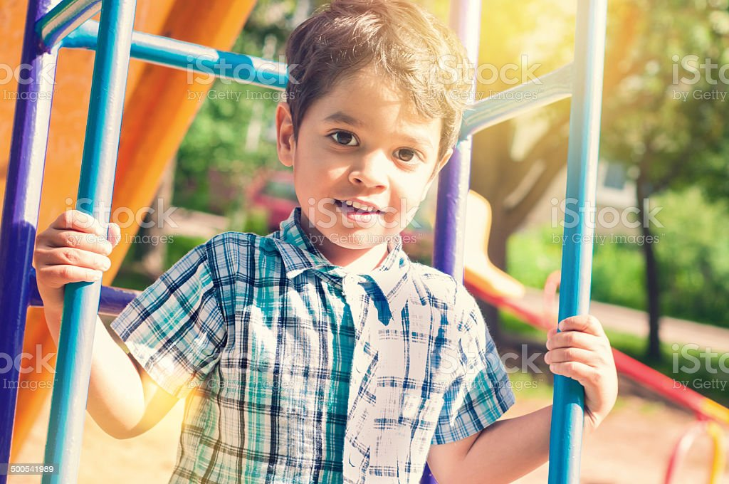 Portrait of a little indian boy outdoors stock photo