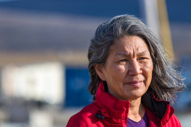 Portrait of a local inuit woman outdoors in Clyde River, Nunavut, Canada. stock photo