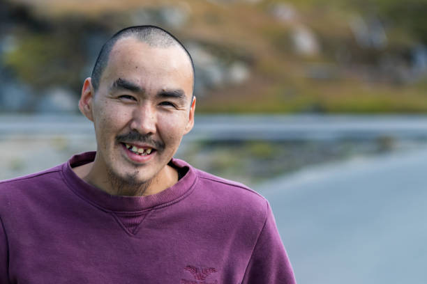 Portrait of a local inuit young man looking camera in Sisimiut, Greenland. stock photo