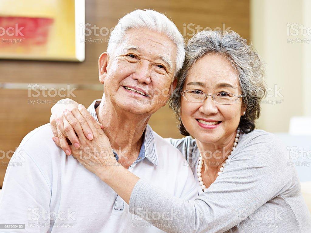 portrait of a loving asian couple stock photo