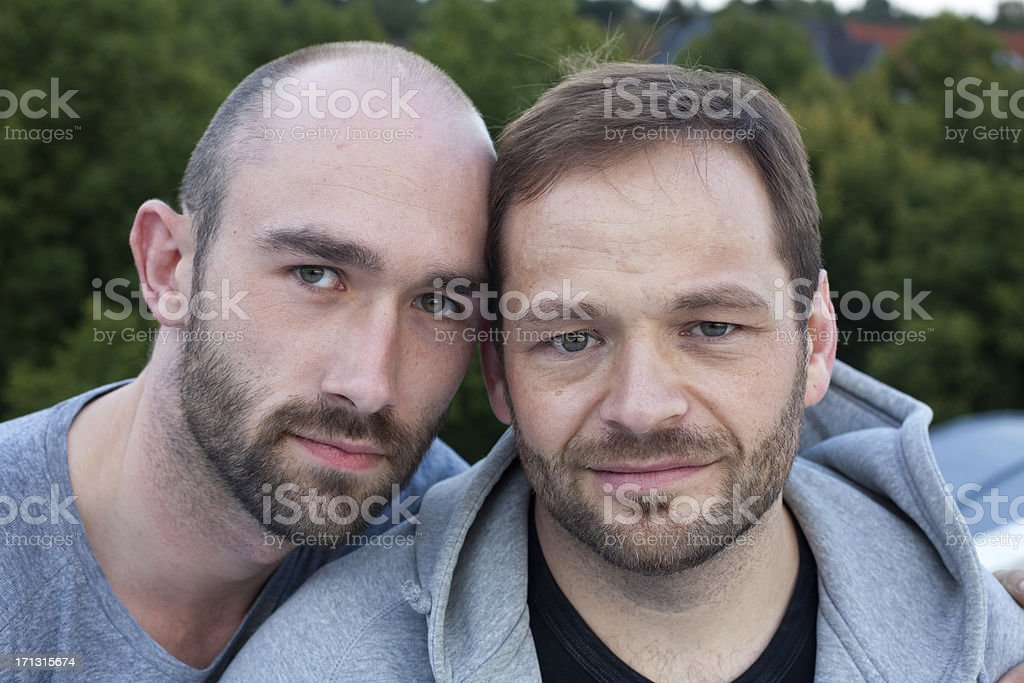 portrait of a loving mid adult gay couple royalty-free stock photo