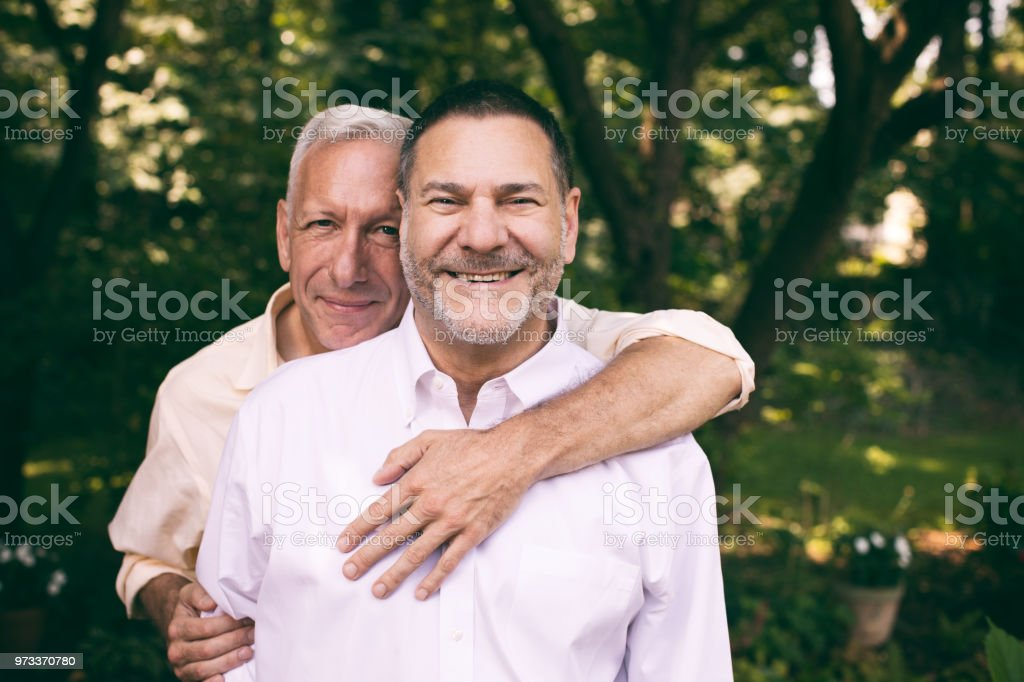 portrait of a loving middle-aged gay couple stock photo