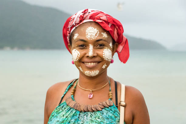 Portrait of a Malagasy woman with her face painted, Vezo-Sakalava tradition, Nosy Be, Madagascar. stock photo