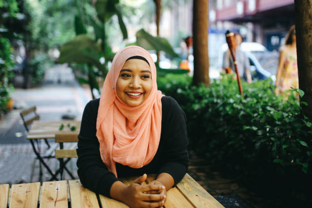 Portrait of a Malaysian woman on the cafe in Kuala Lumpur stock photo