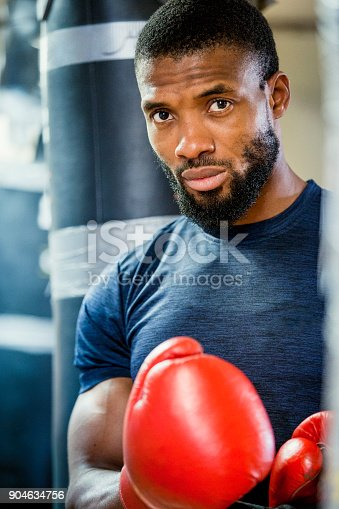 1069872470istockphoto Portrait of a Male Boxer 904634756