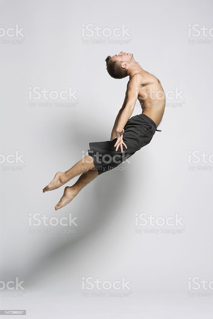 Portrait of a male dancer jumping gracefully stock photo