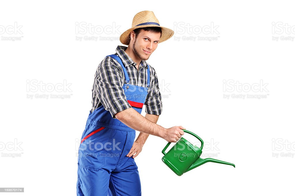 Portrait of a male gardener with watering can royalty-free stock photo