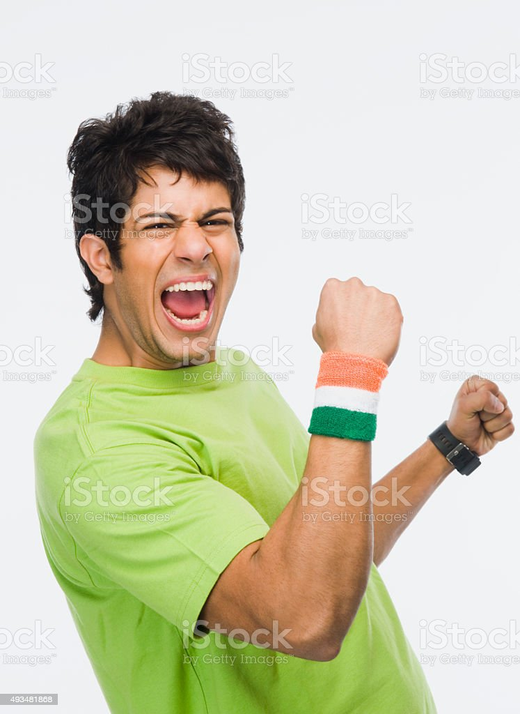 Portrait of a man clenching fist stock photo