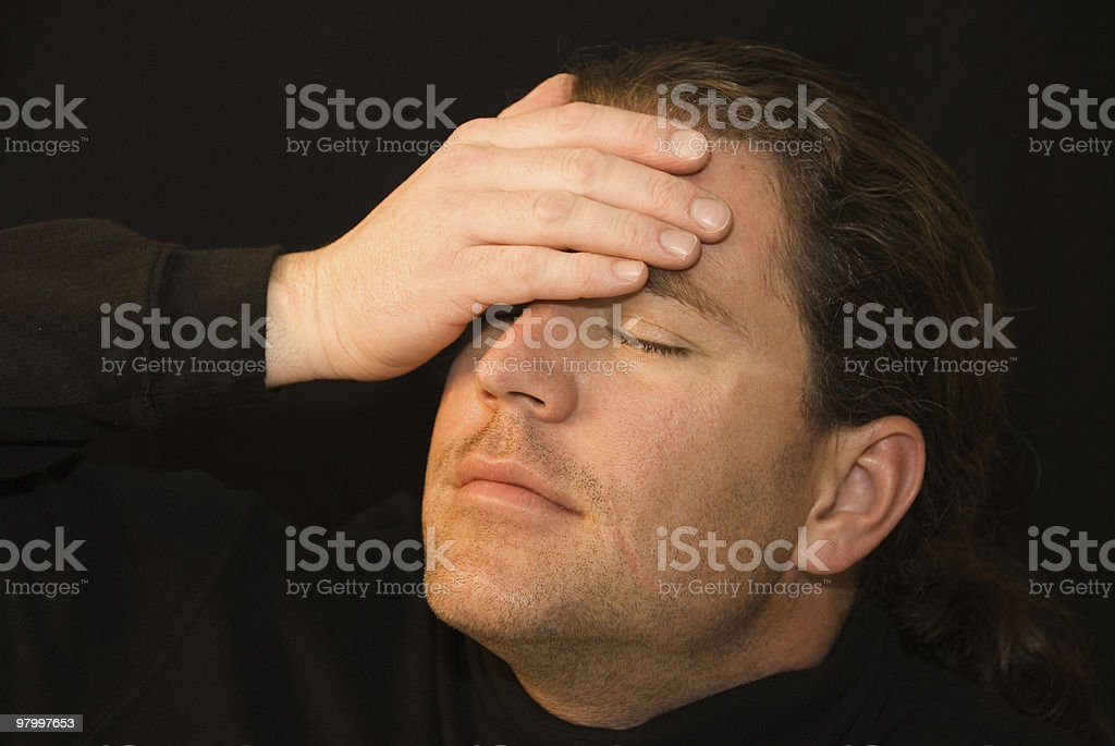 Portrait of a man covering his face with hand royalty free stockfoto