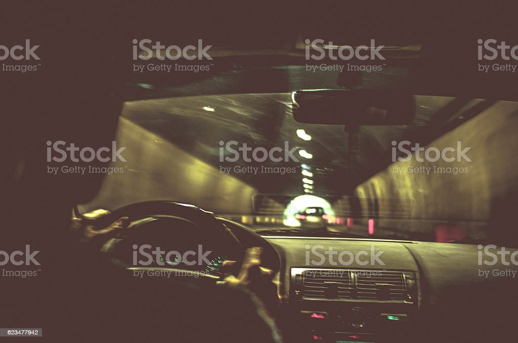 Portrait of a Man driving his Car through the tunnel stock photo