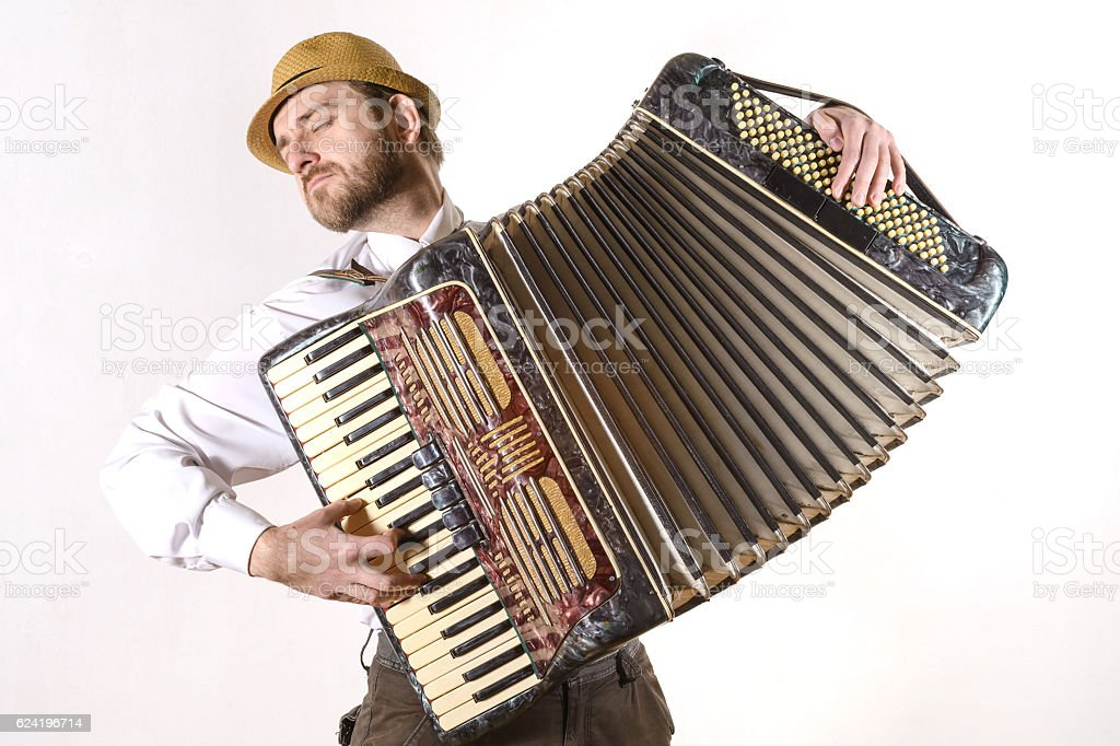 Portrait of a man emotionally playing the accordion stock photo