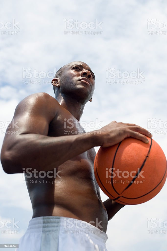 Portrait of a man holding a basketball royalty-free 스톡 사진