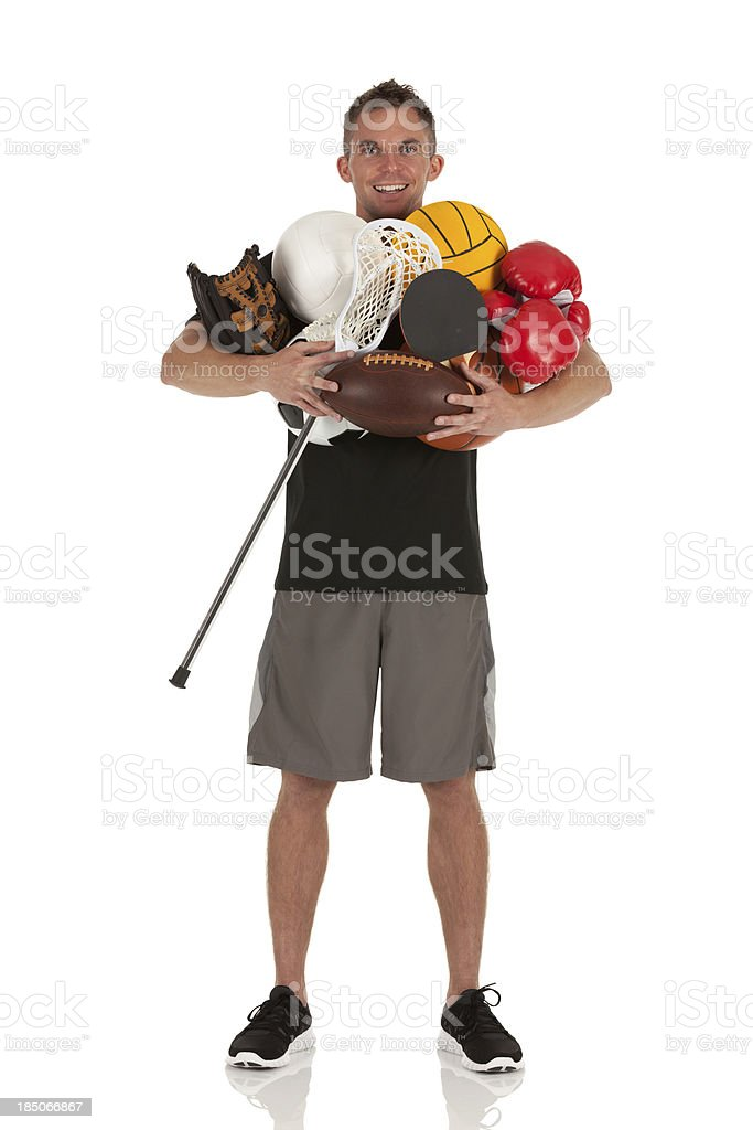 Portrait of a man holding sports equipments royalty-free stock photo