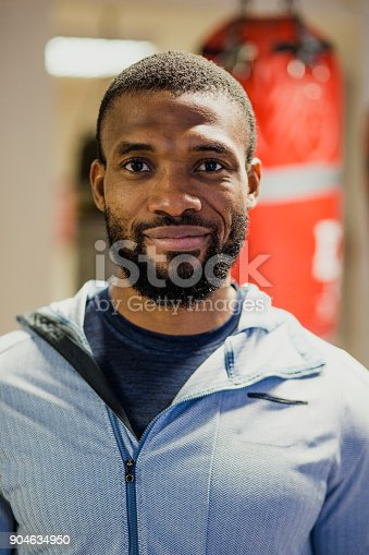 1069872470istockphoto Portrait of a Man in a Boxing Gym 904634950