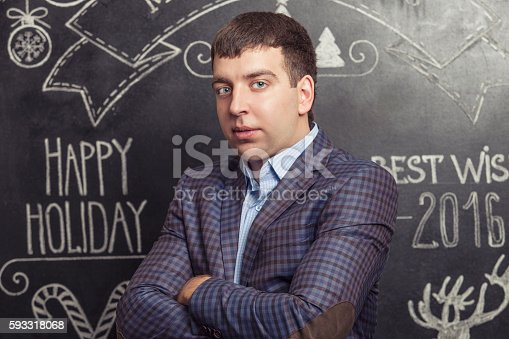 istock Portrait of a man in a jacket against the wall 593318068