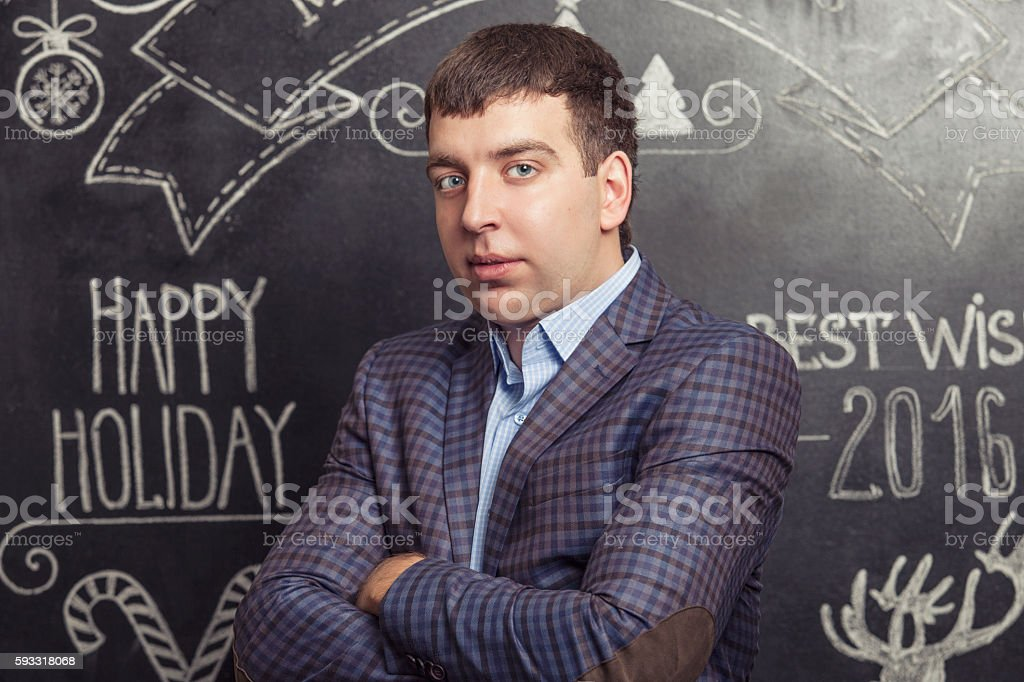 Portrait of a man in a jacket against the wall stock photo