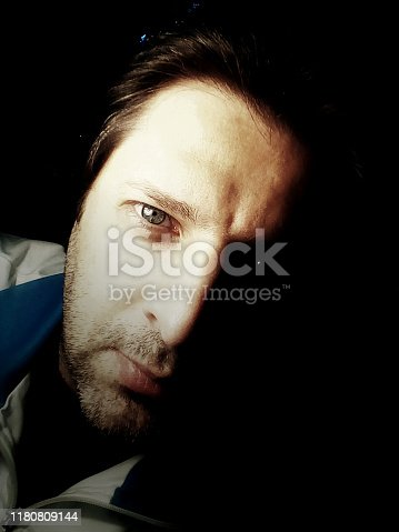 Portrait of a man in the darkness - Photography