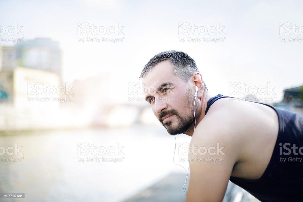 Portrait of a man listening music stock photo