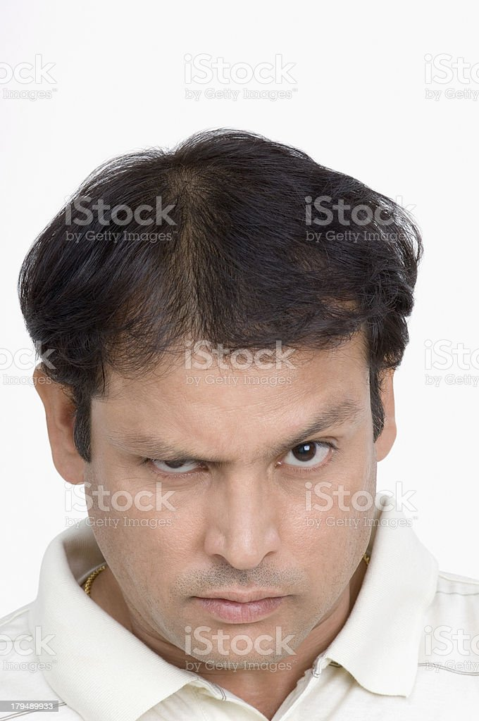 Portrait of a man looking angry royalty-free stock photo