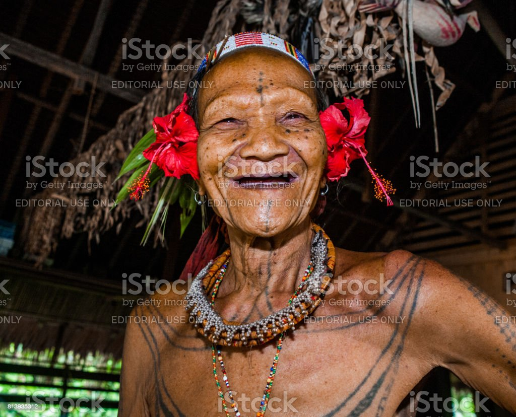 Portrait of a man Mentawai tribe in traditional headdress. stock photo