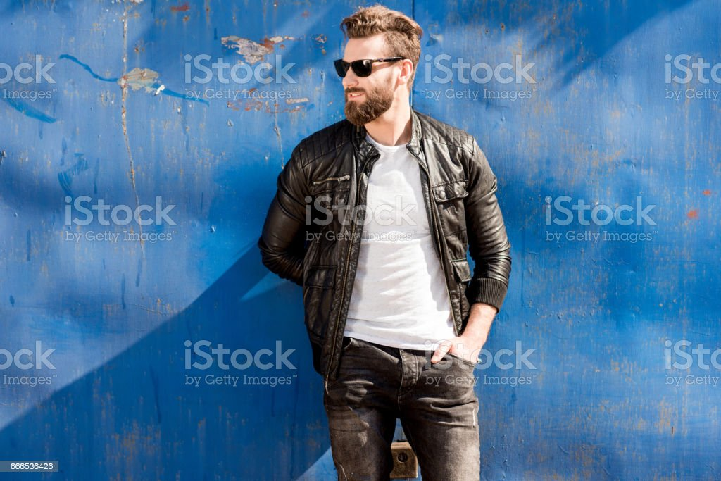 Portrait of a man on the blue background stock photo